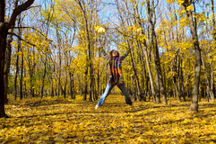 Woman among the autumn leaves Stock Image
