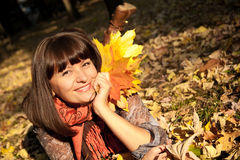 Woman with autumn leaves Stock Photo