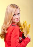 Woman with autumn leaves Royalty Free Stock Photos
