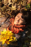 Woman with autumn leaves royalty free stock image