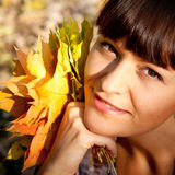 Woman with autumn leaves stock photos