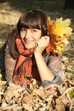 Woman with autumn leaves stock images