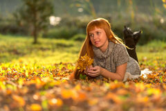 Woman in the autumn leaves.  stock photo