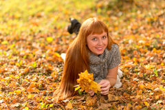 Woman in the autumn leaves.  stock image