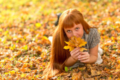 Woman in the autumn leaves.  stock photos