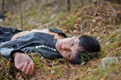 Woman on Autumn leaves. Stock Photography