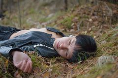 Woman on Autumn leaves. Stock Images