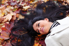 Woman on autumn leaves Royalty Free Stock Photo