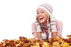 Woman and autumn leaves. Beautiful woman with autumn leaves isolated on whiite background royalty free stock images