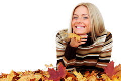 Woman and autumn leaves. Beautiful woman with autumn leaves isolated on whiite background stock photo