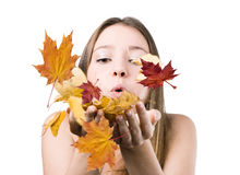 Woman on the autumn leaves blowing Royalty Free Stock Photo