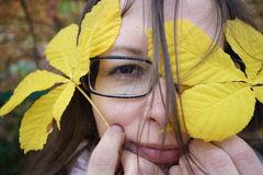 Woman And Autumn Leaves Stock Photography