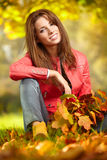 Woman with autumn leaves in hand and fall yellow maple gar Royalty Free Stock Photo