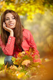 Woman with autumn leaves in hand and fall yellow maple gar Royalty Free Stock Photography