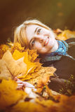 Woman with autumn leaves in hand Stock Image