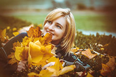Woman with autumn leaves in hand Stock Photos