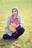 Woman with autumn leaves in hand Royalty Free Stock Image