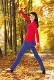 Woman with autumn leaves in hands. Young woman with orange and yellow leaves in hands royalty free stock image