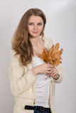 Woman with autumn leaves Stock Image