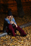 Woman among autumn leaves Stock Images
