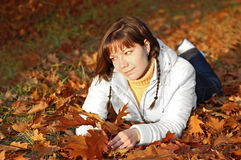 Woman with autumn orange leaves. Young woman in autumn orange leaves in forest stock photos