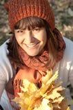 Woman with autumn orange leaves. Portrait of beautiful woman with autumn orange leaves stock images