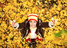 Woman in autumn orange leaves, outdoor Royalty Free Stock Photos