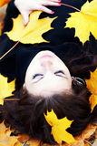 Woman in autumn orange leaves. Young woman in autumn orange leaves royalty free stock image