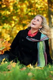 Woman at autumn outdoors Stock Photos