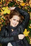 Woman at autumn outdoors Stock Photos