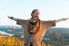 Woman in autumn outdoors in evening rejoicing Royalty Free Stock Photography