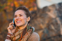 Woman in autumn  outdoors talking cell phone Stock Photos