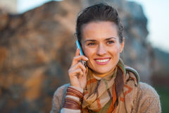 Woman in autumn  outdoors talking cell phone Stock Image