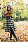 Woman  in autumn park Stock Photography