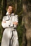 Woman in the autumn park Stock Photos