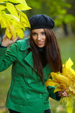 Woman in autumn park. Royalty Free Stock Images