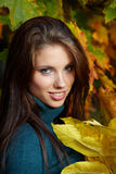 Woman in autumn park. Royalty Free Stock Photography