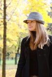 Woman in autumn park Royalty Free Stock Photos