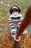 Woman in the autumn park. Stock Photos