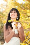Woman in the autumn park Royalty Free Stock Image
