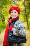 Woman  in  autumn park Royalty Free Stock Photos