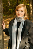Woman in autumn park Royalty Free Stock Image