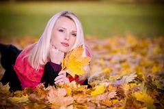 Woman in the autumn park Royalty Free Stock Photo