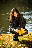 Woman in the autumn park Royalty Free Stock Photography