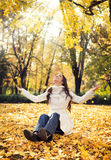 Woman in autumn park. Beautiful young woman in autumn park royalty free stock photography