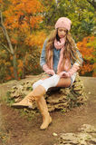 Woman in the autumn park. Stock Images