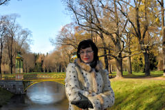 Woman in autumn park Royalty Free Stock Images