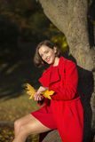 Woman at autumn park and goldy leaves. Young woman at autumn park and goldy leaves Royalty Free Stock Photography