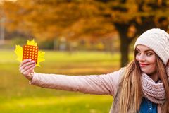 Woman in autumn park holding vitamins medicines Stock Photography