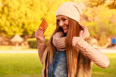 Woman in autumn park holding vitamins medicines Royalty Free Stock Photos